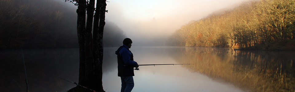 Fisherman on a foggy river to Cheissoux